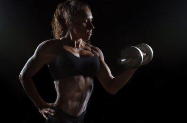 muscular woman dumbbell