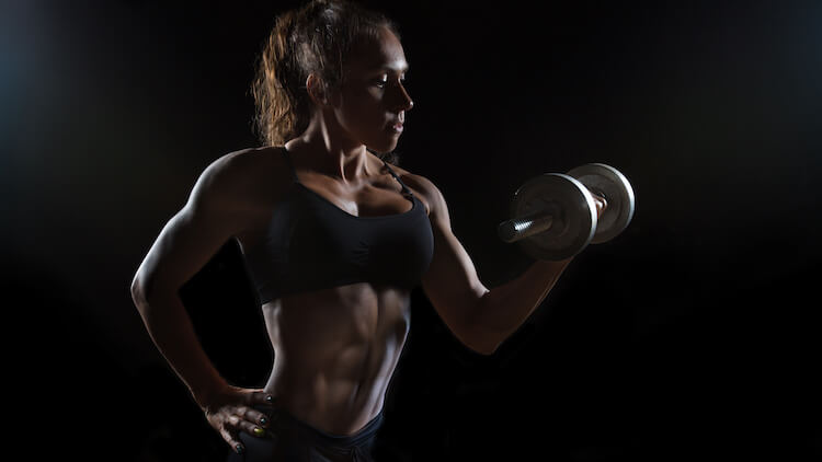 muscular woman dumbbell